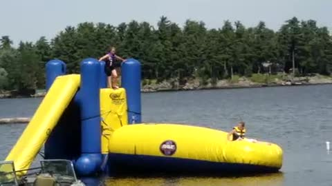 Girl Fails To Launch Her Brother Off Inflatable Bounce Pillow