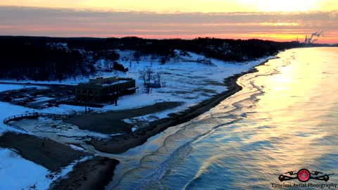 Winter Sunset At Indiana Dunes State Park With the Start of Shelf Ice