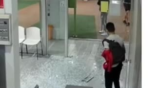Woman walks right into glass door, sends it shattering