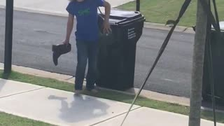 Brother throws a boot at sister