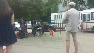 Strolling musicians from Cuba play on the sidewalk in Russia  - Video