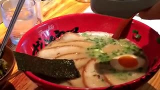 Squeezing garlic in Japanese Ramen - Video
