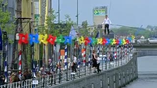 Tightrope Walkers Balance Over Brussels Canal - Video