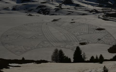 Snow artist uses massive area to create detailed drawing