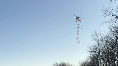 Talented Pilot Shows Amazing Skills Attaching Two Sections Of A Pylon