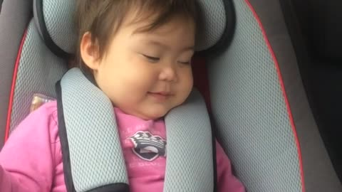 Baby fakes sleeping in order to stay in car