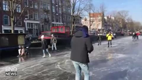 Ice skaters grace over frozen canals during Netherlands cold snap