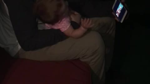 Baby laughing at a video of herself