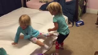 Identical twin toddlers tickle each other  - Video