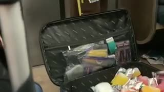 Man sells pepper spray, mixed drinks, and capri sun in a suitcase on subway train