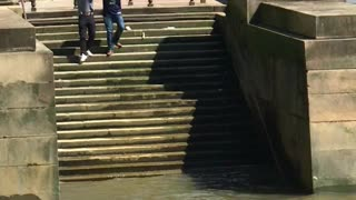 Guy Experiences A Solid Fall Down Some Slippery Steps On The Thames River