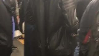 Guy in hoodie wears samurai sword in subway terminal - Video