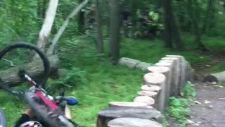 Man red bike face plant tree stumps - Video