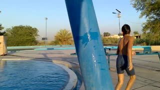 Kids are enjoying swimming in swimming pool in summer  - Video