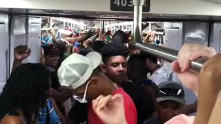 Rio de janeiro subway party, passengers sing and dance together