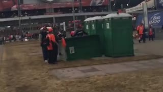 Broncos fan allegedly kicks over Porta-Potty with Patriots fan inside - Video