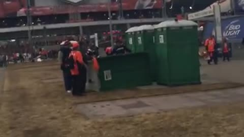 Broncos fan allegedly kicks over Porta-Potty with Patriots fan inside