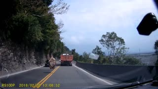 Falling Boulder Nearly Hits Multiple Cars - Video
