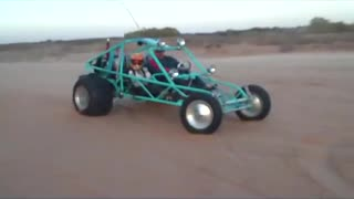 Sandfill and copilot doing wheelies in the SandSquatch Sand Rail - Video