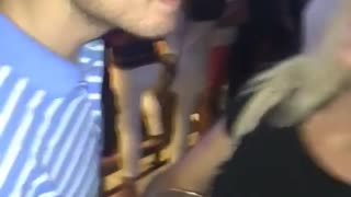 Guy blue shirt about to kiss girl  - Video