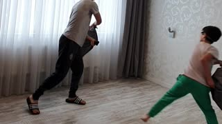 Blindfolded Pillow Fight Between Brothers