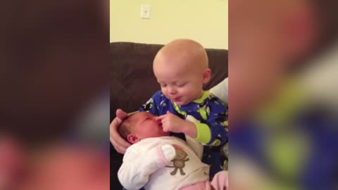 Tot Boy Tries To Pick His Newborn Sister's Nose Repeatedly