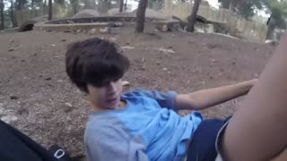 Aaron fails his attempt at a backflip off a tree - Video