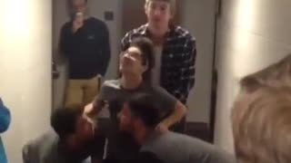 Couple of guys launch their friend into the roof of their dorm hall - Video