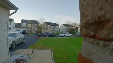 Woman in blue sweater falls on front yard