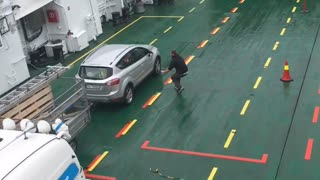 Driverless Car Slides on Ferry Deck - Video