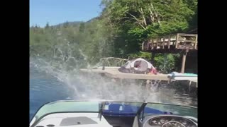 Boy falls off the roof and into the lake - Video