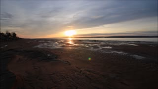 Bay of Fundy time lapse documents beautiful sunset and rising tides - Video