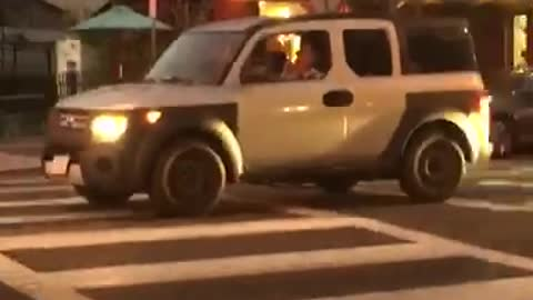 White car person playing music from flute traffic train