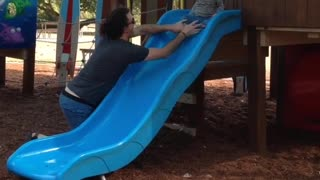 Collab copyright protection - pony tail dad saves toddler on slide