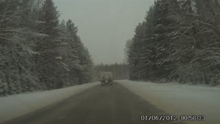 SUV Loses control and crashes into a truck