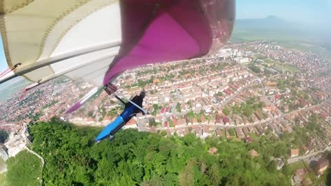 Hang gliding above citadel and back-country skiing