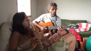 Happy Moment When Parents Sing to Their Baby
