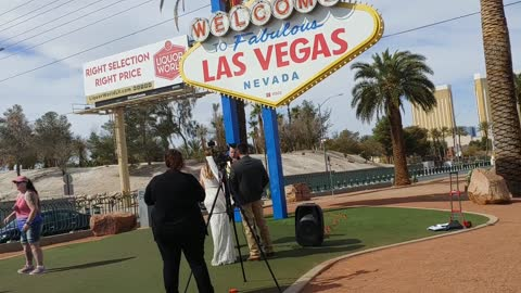 Elvis marries couple under the Welcome to Las Vegas Sign
