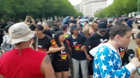 Communists in D.C. try to burn American flag