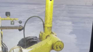 Grader on a frozen Lake