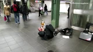 Man glasses green sweater trumpet on floor - Video