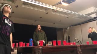 Beer pong expert catches ping pong ball in mouth and spits it across table into opponants cup - Video