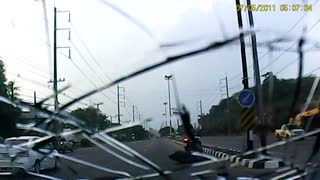 Reckless Biker Hits Car - Video