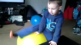 Boy sits pops yellow balloon cries - Video