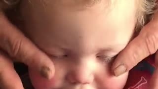 Grandpa gives baby relaxing face massage - Video