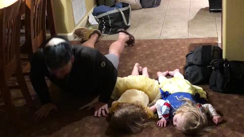 "Little girls hilariously attempt to do ""the worm"" dance move"