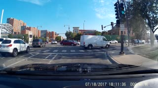 Cyclist Runs Red Light Gets Critically Injured By Car - Video