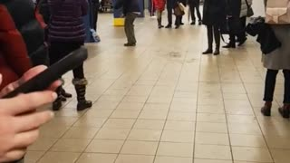 Zoom in on man dancing in subway station - Video
