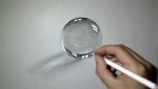Artist creates realistic drawing of Crystal Ball - Video