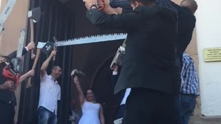 Newlyweds Receive Unique Chainsaw Wedding Send-Off On Their Big Day